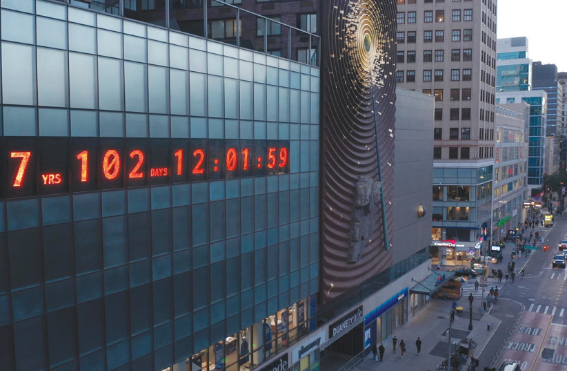 ON ROSH HASHANAH, the iconic Metronome clock in New York City was repurposed as an 80-foot-wide climate clock that shows our remaining time to take urgent action on climate change. (credit: BEN WOLF)
