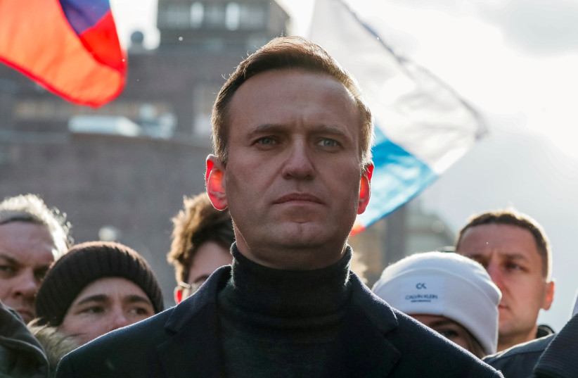 Russian opposition politician Alexei Navalny takes part in a rally to mark the 5th anniversary of opposition politician Boris Nemtsov's murder and to protest against proposed amendments to the country's constitution, in Moscow, Russia February 29, 2020. (photo credit: REUTERS)