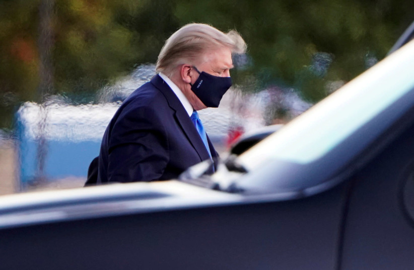 """U.S. President Donald Trump arrives at Walter Reed National Military Medical Center by helicopter after the White House announced that he """"will be working from the presidential offices at Walter Reed for the next few days"""" after testing positive for the coronavirus disease (COVID-19), in Bethesda, M (photo credit: REUTERS/JOSHUA ROBERTS/FILE PHOTO)"""