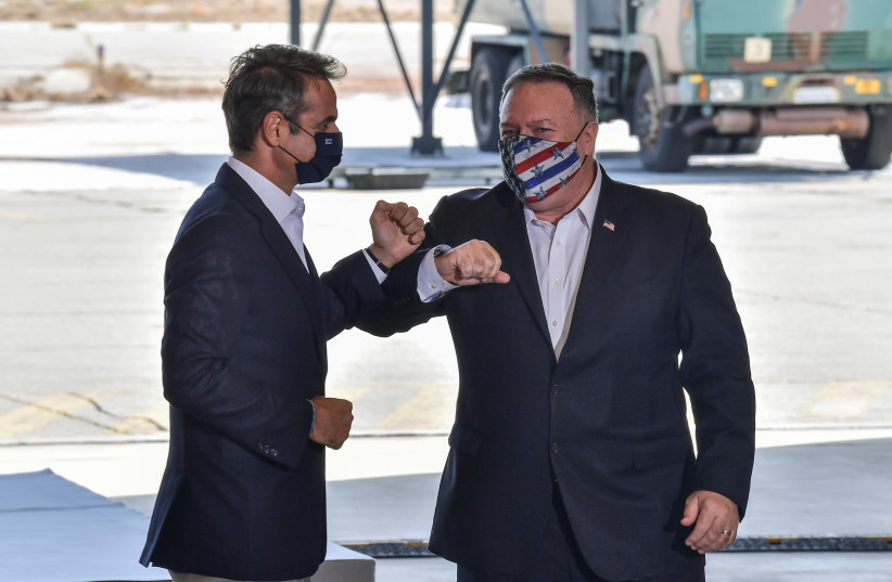 US Secretary of State Mike Pompeo and Greek Prime Minister Kyriakos Mitsotakis visit the Naval Support Activity base at Souda, Crete, Greece September 29, 2020. (photo credit: REUTERS)