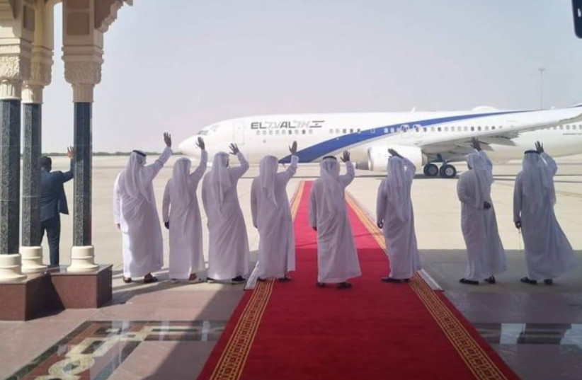 United Arab Emirates delegates wave to the departing El Al plane at the end of IsraelUAE normalization talks in Abu Dhabi on September 1 (photo credit: EL AL)