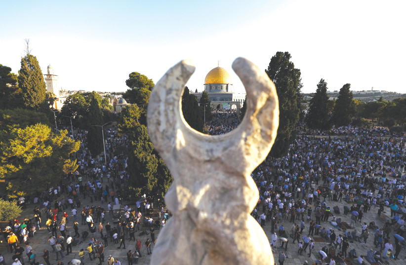 MUSLIMS PRAY as they mark the holiday of Eid al-Adha in the compound known to Muslims as Noble Sanctuary and to Jews as the Temple Mount, in July.  (photo credit: AMMAR AWAD/REUTERS)