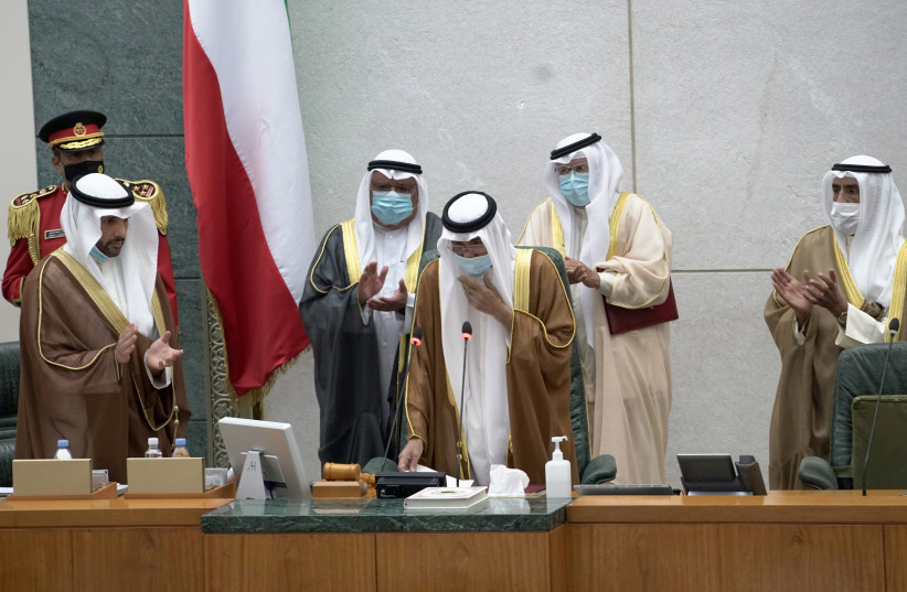 Kuwait's new Emir Nawaf al-Ahmad al-Sabah takes the oath of office at the parliament, in Kuwait City, Kuwait September 30, 2020 (photo credit: REUTERS/STEPHANIE MCGEHEE)