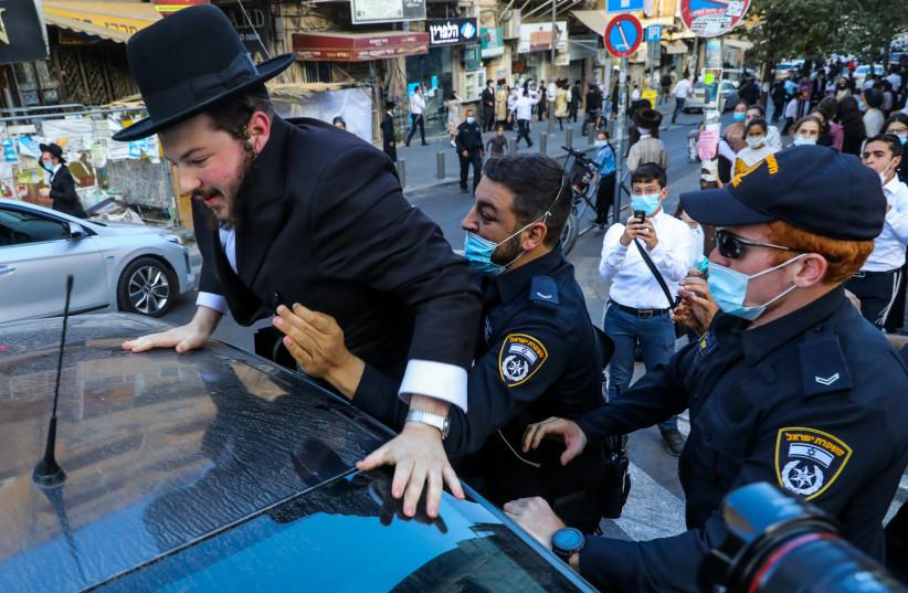 POLICE IN Jerusalem detain a haredi protester last week. (photo credit: MARC ISRAEL SELLEM/THE JERUSALEM POST)