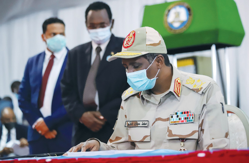 LT.-GEN. MOHAMED Hamdan Dagalo signs a peace agreement between Sudan's power-sharing government and five key rebel groups, in Juba, South Sudan, on August 31, 2020. (photo credit: REUTERS)