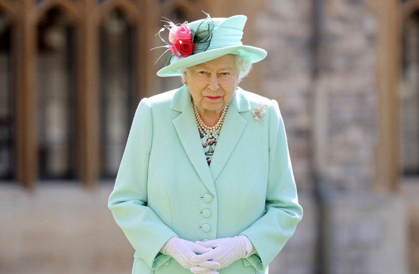 Britain's Queen Elizabeth poses after awarding Captain Tom Moore with the insignia of Knight Bachelor at Windsor Castle, in Windsor, Britain July 17, 2020. (photo credit: REUTERS/CHRIS JACKSON)