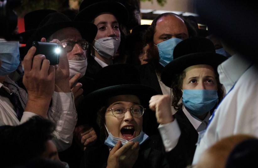 Ultra-Orthodox Jews gather in the Borough Park neighborhood of Brooklyn to protest against coronavirus disease (COVID-19) restrictions in New York, US, October 7, 2020.  (photo credit: REUTERS/YUKI IWAMURA)