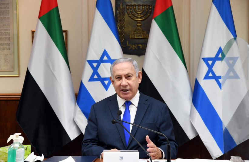 Prime Minister Benjamin Netanyahu speaks as the government approves the peace deal between Israel and the UAE, October 12, 2020 (photo credit: HAIM ZACH/GPO)