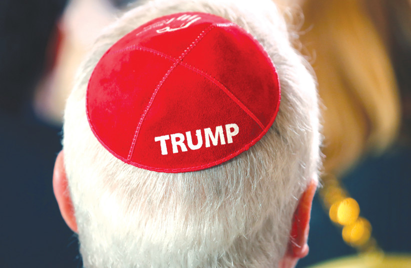 A MAN wears a Trump kippah while waiting for Trump to address the Republican Jewish Coalition 2019 Annual Leadership Meeting in Las Vegas. (photo credit: KEVIN LAMARQUE/REUTERS)