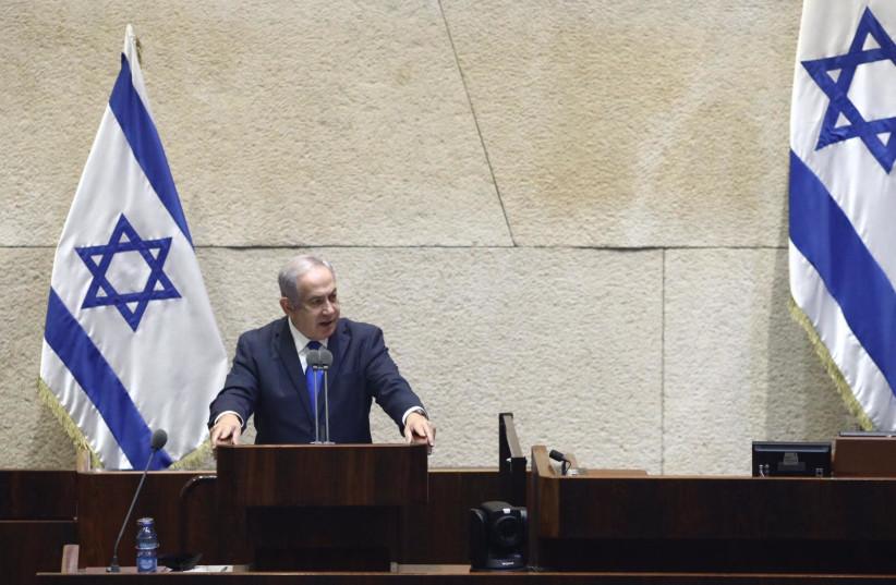 Prime Minister Benjamin Netanyahu speaks at Knesset plenum on Israel-UAE deal (photo credit: GIDON SHARON)