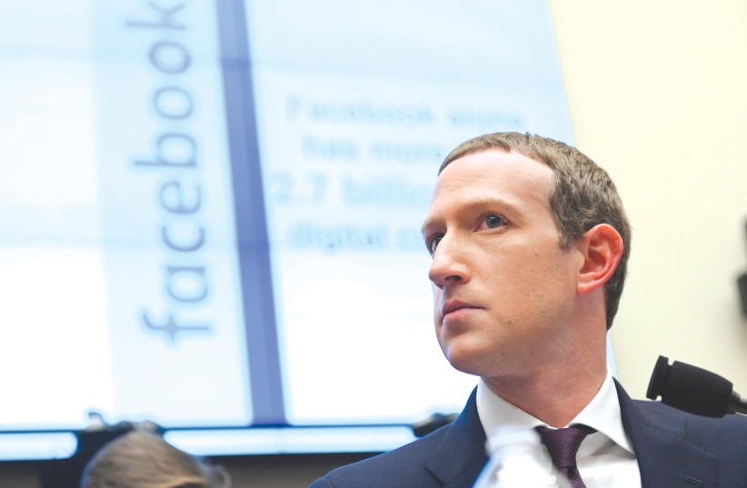 It took time, but Facebook CEO Mark Zuckerberg should be commended for banning content that denies and distorts the Holocaust.  (photo credit: ERIN SCOTT/REUTERS)
