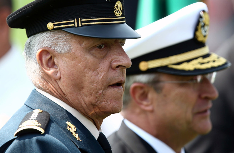 Mexico's Defense Minister General Salvador Cienfuegos and Secretary of the Navy Admiral Vidal Francisco Soberon take part in Flag Day celebrations at Campo Marte in Mexico City, Mexico February 24, 2018.  (photo credit: EDGARD GARRIDO/ REUTERS)