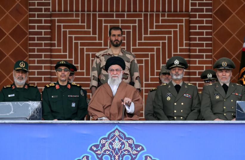 Iran's Supreme Leader Ayatollah Khamenei surrounded by military officials (photo credit: KHAMENEI.IR)