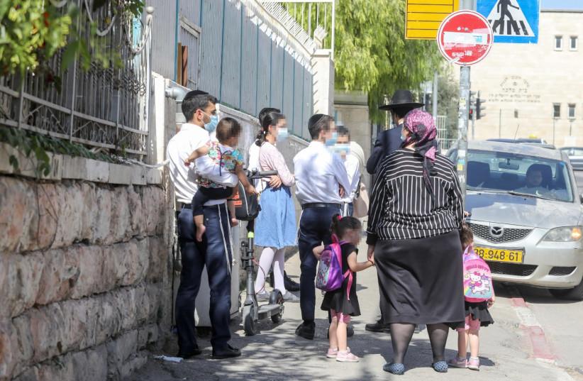 A haredi family walks down the street in the Makor Baruch neighborhood of Jerusalem (photo credit: MARC ISRAEL SELLEM)