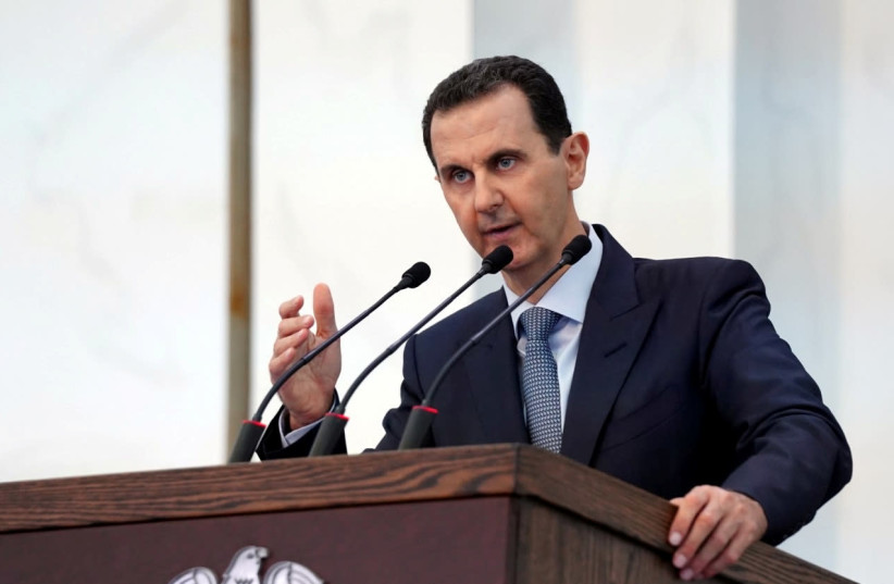 Syria's President Bashar al-Assad addresses the new members of parliament in Damascus, Syria in this handout released by SANA on August 12, 2020 (photo credit: SANA/HANDOUT VIA REUTERS)