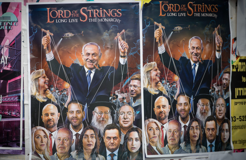 A poster of Prime Minister Benjamin Netanyahu as a puppetmaster, Rothschild Boulevard in Tel Aviv, September 10, 2020 (photo credit: MIRIAM ALSTER/FLASH90)