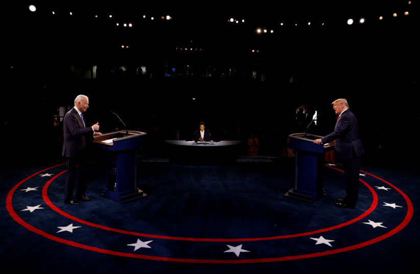 President Trump and Democratic presidential nominee Biden participate in their second debate in Nashville (photo credit: REUTERS)