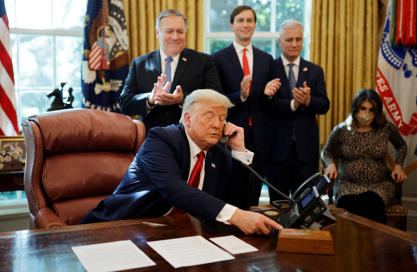 U.S. President Donald Trump is seen on the phone with leaders of Israel and Sudan. (photo credit: REUTERS/CARLOS BARRIA)
