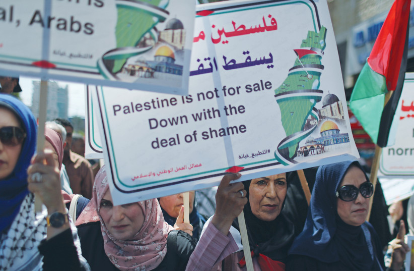 Women in Gaza City protest normalization of relations between the UAE and Israel, in August, 2020. (photo credit: REUTERS)