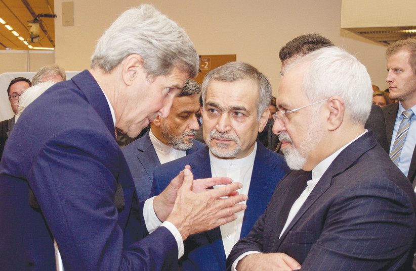 FORMER US secretary of state John Kerry speaks to Iranian Foreign Minister Javad Zarif as Hossein Fereydoun, the brother of Iranian President Hassan Rouhani, looks on in Vienna, Austria, July 14, 2015. (photo credit: US STATE DEPARTMENT/ REUTERS)