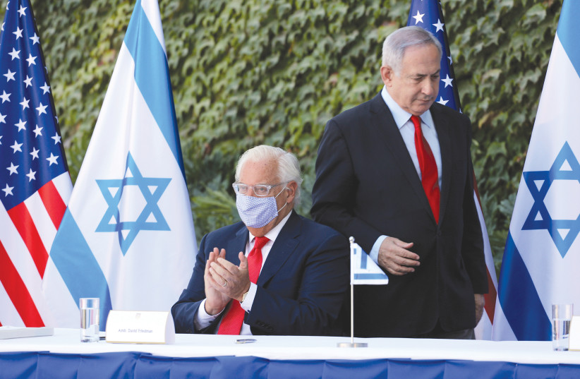 PRIME MINISTER Benjamin Netanyahu and US Ambassador to Israel David Friedman attend Wednesday's ceremony in Ariel that extended Israel-US scientific cooperation agreement in West Bank and Golan Heights. (photo credit: EMIL SALMAN/REUTERS)