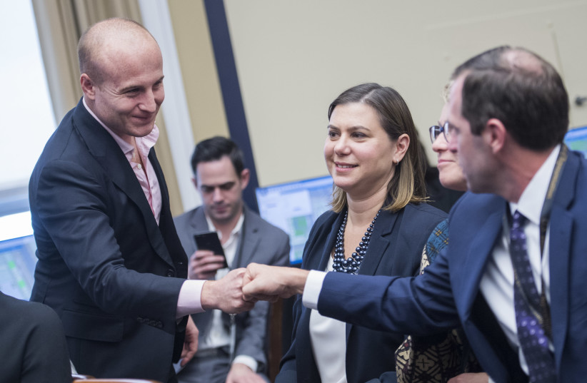 Max Rose, left, and Elissa Slotkin, center, seen in the Rayburn Building in Washington, D.C., after being elected in 2018. Both are in tight races to retain their seats. (photo credit: TOM WILLIAMS/CQ ROLL CALL)