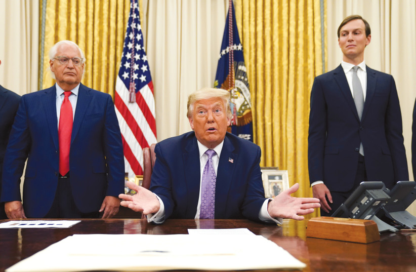 US AMBASSADOR to Israel David Friedman and White House senior adviser Jared Kushner stand behind US President Donald Trump in the Oval Office in August. (photo credit: KEVIN LAMARQUE/REUTERS)