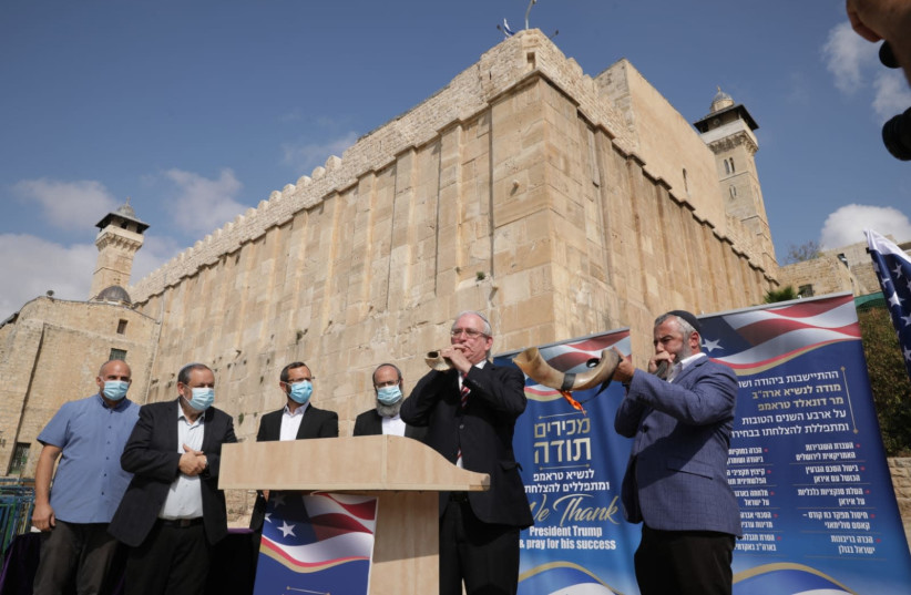 Settlers pray for a Trump victory and blow the shofar outside the Tomb of the Patriarchs in Hebron, November 2, 2020 (photo credit: MOUNT HEBRON REGIONAL COUNCIL SPOKESPERSON'S OFFICE)