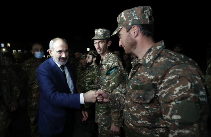 Armenian Prime Minister Nikol Pashinyan greets reservists at the Defence Ministry's base before their departure for the breakaway region of Nagorno-Karabakh in Yerevan, Armenia, October 16, 2020. (photo credit: ARMENIAN PRIME MINISTER PRESS SERVICE/TIGRAN MEHRABYAN/PAN PHOTO VIA REUTERS)