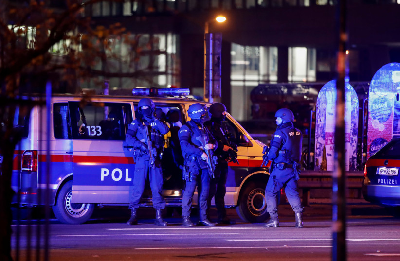 Police officers stand guard on a street after exchanges of gunfire in Vienna, Austria November 3, 2020 (photo credit: LEONHARD FOEGER / REUTERS)