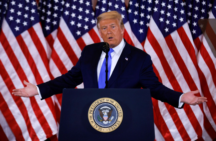 US President Donald Trump speaks about early results from the 2020 US presidential election in the East Room of the White House in Washington, US, November 4, 2020. (photo credit: CARLOS BARRIA / REUTERS)