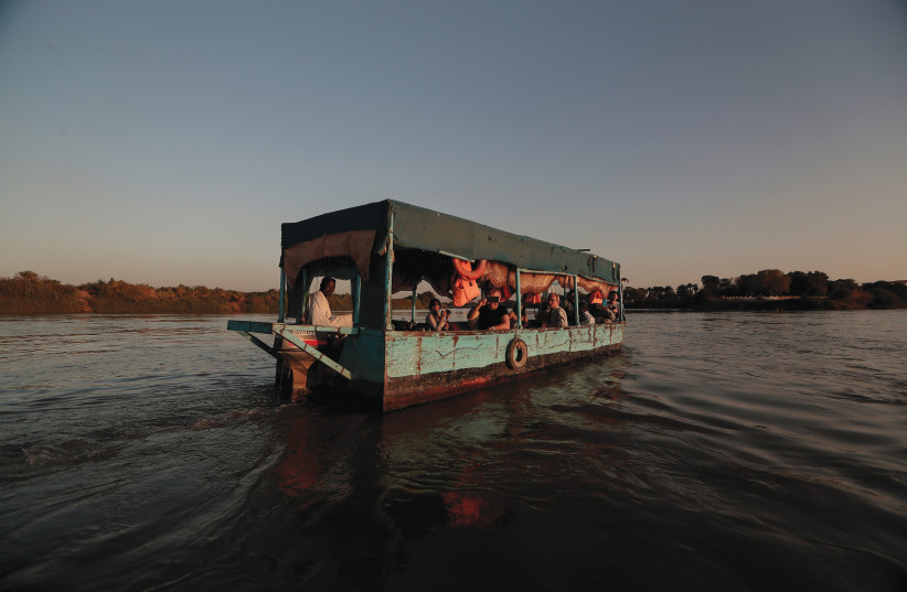 TOURISTS SAIL across the convergence between the White Nile river and Blue Nile river in Khartoum, Sudan, on February 15.  (photo credit: ZOHRA BENSEMRA/REUTERS)