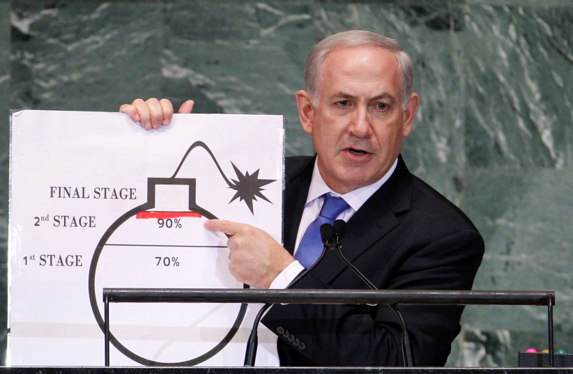 Israel's Prime Minister Benjamin Netanyahu points to a red line he has drawn on the graphic of a bomb as he addresses the 67th United Nations General Assembly at the U.N. Headquarters in New York, U.S., September 27, 2012. (photo credit: REUTERS)