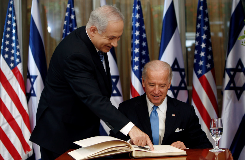 U.S. Vice President Joe Biden (R) prepares to sign the guest book before his meeting with Israel's Prime Minister Benjamin Netanyahu at Netanyahu's residence in Jerusalem March 9, 2010. (photo credit: REUTERS/Ronen Zvulun)