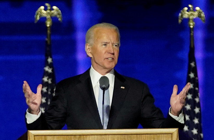 Democratic 2020 US presidential nominee Joe Biden speaks at his election rally, after news media announced that Biden has won the 2020 US presidential election, in Wilmington, Delaware, US, November 7, 2020. (photo credit: ANDREW HARNIK/POOL VIA REUTERS)
