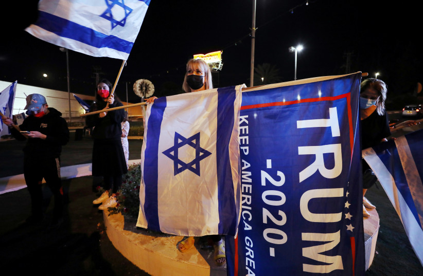 US President Donald Trump supporters take part in a rally ahead of the US presidential election day in Beit Shemesh, Israel November 2, 2020 (photo credit: AMMAR AWAD/REUTERS)