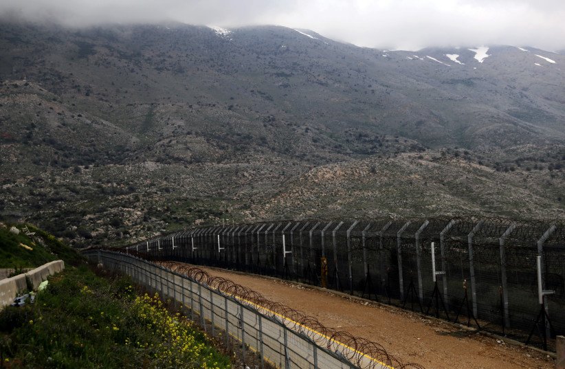 Fences are seen on the ceasefire line between Israel and Syria in the Golan Heights March 25, 2019. (photo credit: AMMAR AWAD/REUTERS)