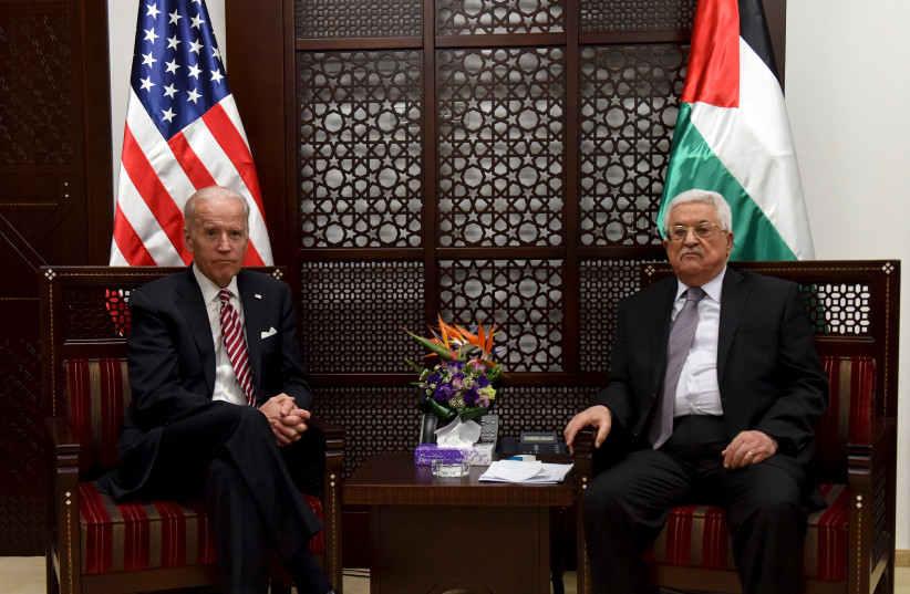 Then US Vice-President Joe Biden (L) meets with Palestinian President Mahmoud Abbas in the West Bank city of Ramallah March 9, 2016 (photo credit: REUTERS/DEBBIE HILL/POOL)