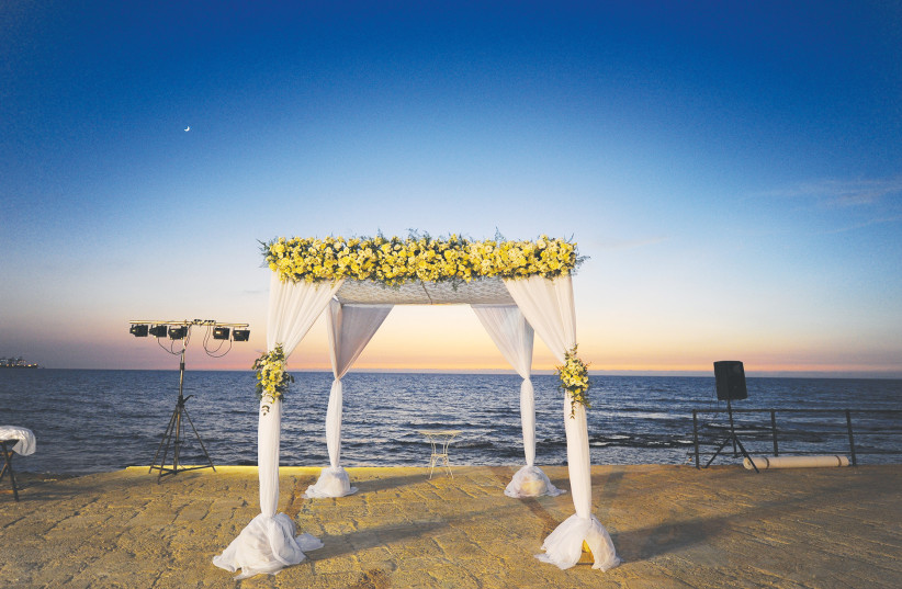 An illustrative photo of a Jewish wedding in front of the Mediterranean Sea. (photo credit: MENDY HECHTMAN/FLASH90)