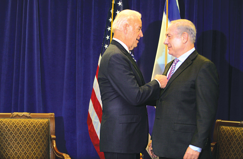 JOE BIDEN, then-US vice president, speaks with Prime Minister Benjamin Netanyahu during a meeting in New Orleans, Louisiana, in 2010. (photo credit: LEE CELANO/REUTERS)