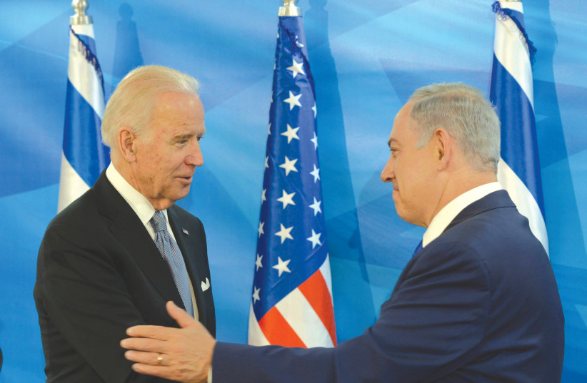 PRIME MINISTER Benjamin Netanyahu meets with then-US vice president Joe Biden in Jerusalem in 2016. (photo credit: AMOS BEN-GERSHOM/GPO)