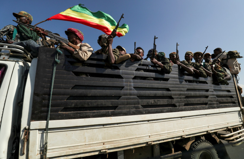 Members of Amhara region militias ride on their truck as they head to face the Tigray People's Liberation Front (TPLF), in Sanja, Amhara region near a border with Tigray, Ethiopia November 9, 2020.  (photo credit: REUTERS/TIKSA NEGERI)