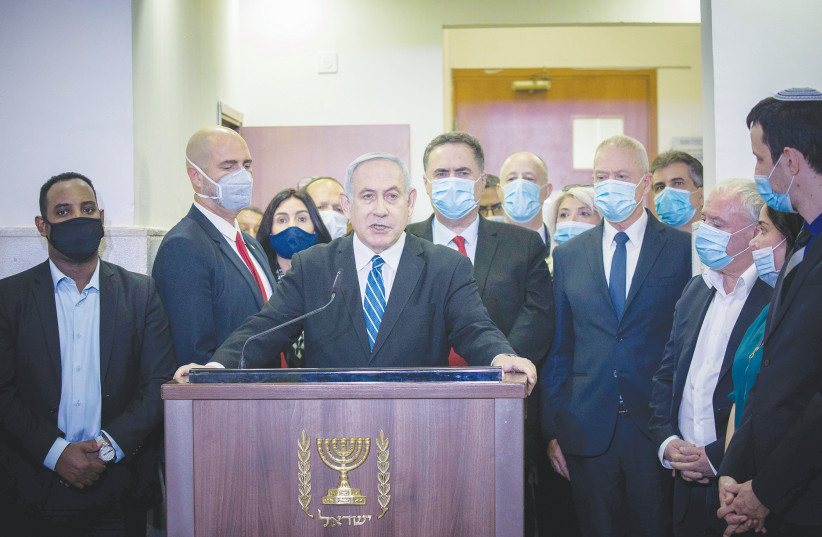 PRIME MINISTER Benjamin Netanyahu gives a press statement ahead of the start of his trial at the District Court in Jerusalem in May. (photo credit: YONATAN SINDEL/FLASH 90)