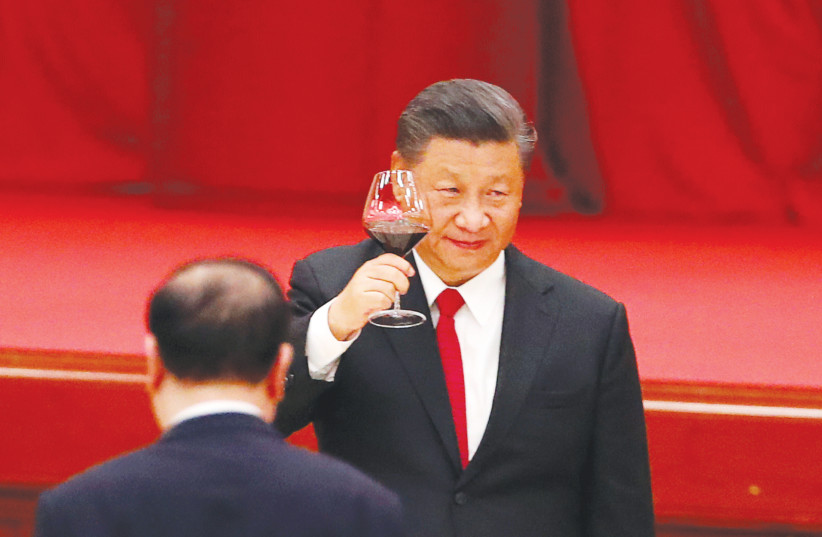 CHINESE PRESIDENT Xi Jinping makes a toast on the eve of the 71st anniversary of the founding of the People's Republic of China, in Beijing on September 30.  (photo credit: REUTERS)