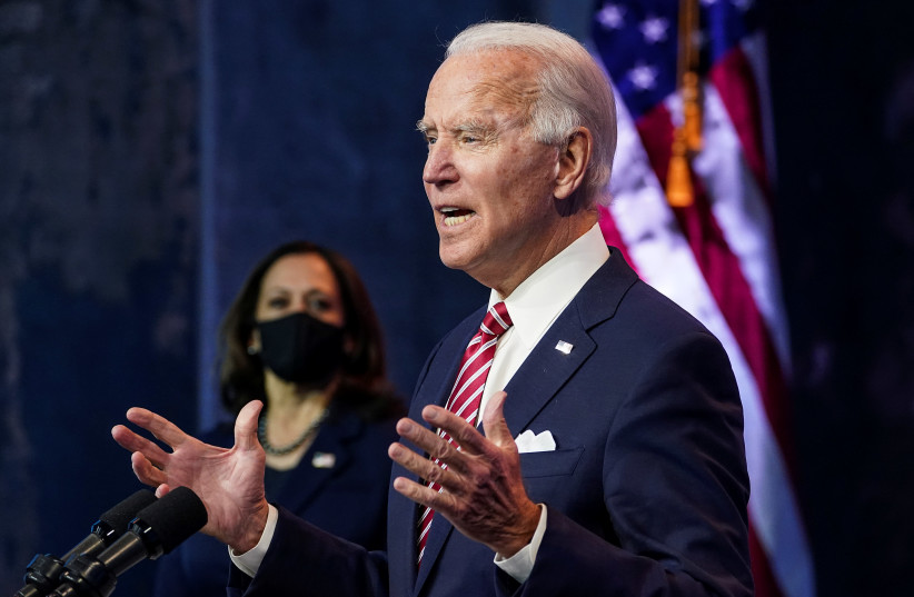US President-elect Joe Biden speaks about the US economy as Vice President-elect Kamala Harris stands by, Wilmington, Delaware, US, November 16, 2020. (photo credit: REUTERS/KEVIN LAMARQUE)