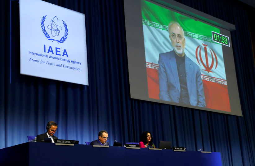 IAEA director-general Rafael Grossi listens as head of Iran's Atomic Energy Organization Ali-Akbar Salehi delivers his speech at the opening of the IAEA General Conference at their headquarters in Vienna, Austria September 21, 2020 (photo credit: REUTERS/LEONHARD FOEGER)