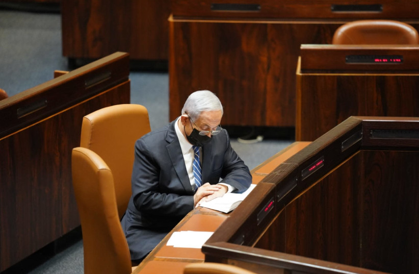 Prime Minister Benjamin Netanyahu attends a Knesset vote on a bill that would prevent anyone under criminal indictment from serving as prime minister, November 18, 2020 (photo credit: KNESSET SPOKESPERSON/DANI SHEM TOV)