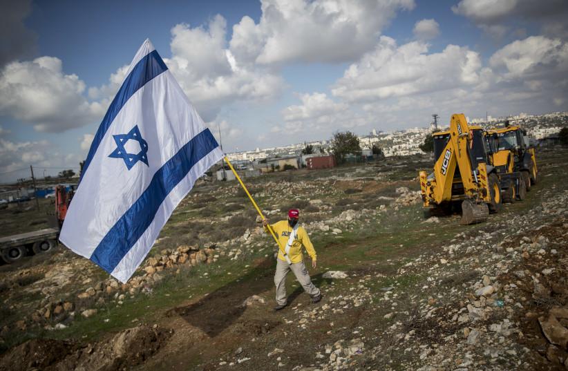 SHOWING NATIONAL pride in the Givat Hamatos neighborhood on November 16. (photo credit: YONATAN SINDEL/FLASH 90)