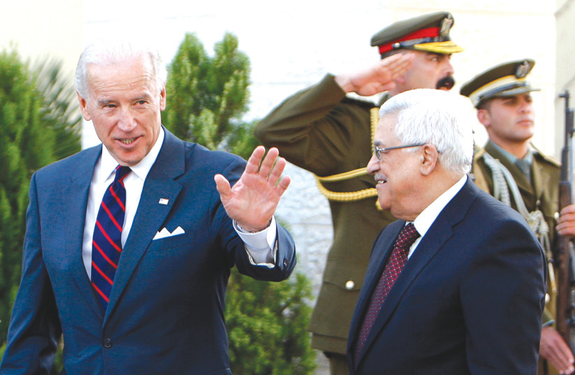 THEN-US vice president Joe Biden gestures as he walks with Palestinian Authority President Mahmoud Abbas after the two met in Ramallah in 2010. (photo credit: MOHAMAD TOROKMAN/REUTERS)