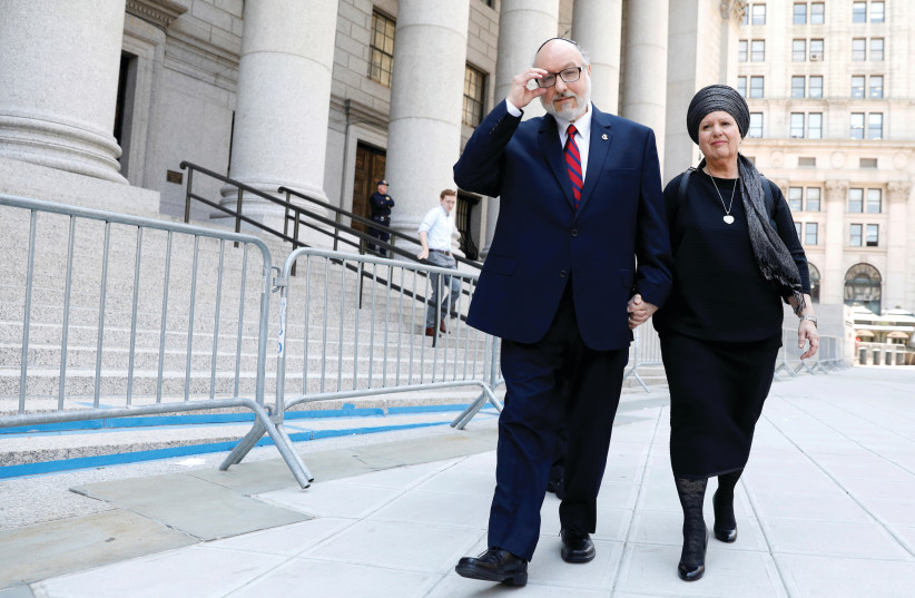 JONATHAN POLLARD and his wife, Esther, exit Manhattan Federal Courthouse in New York City, in 2017. (photo credit: BRENDAN MCDERMID/REUTERS)